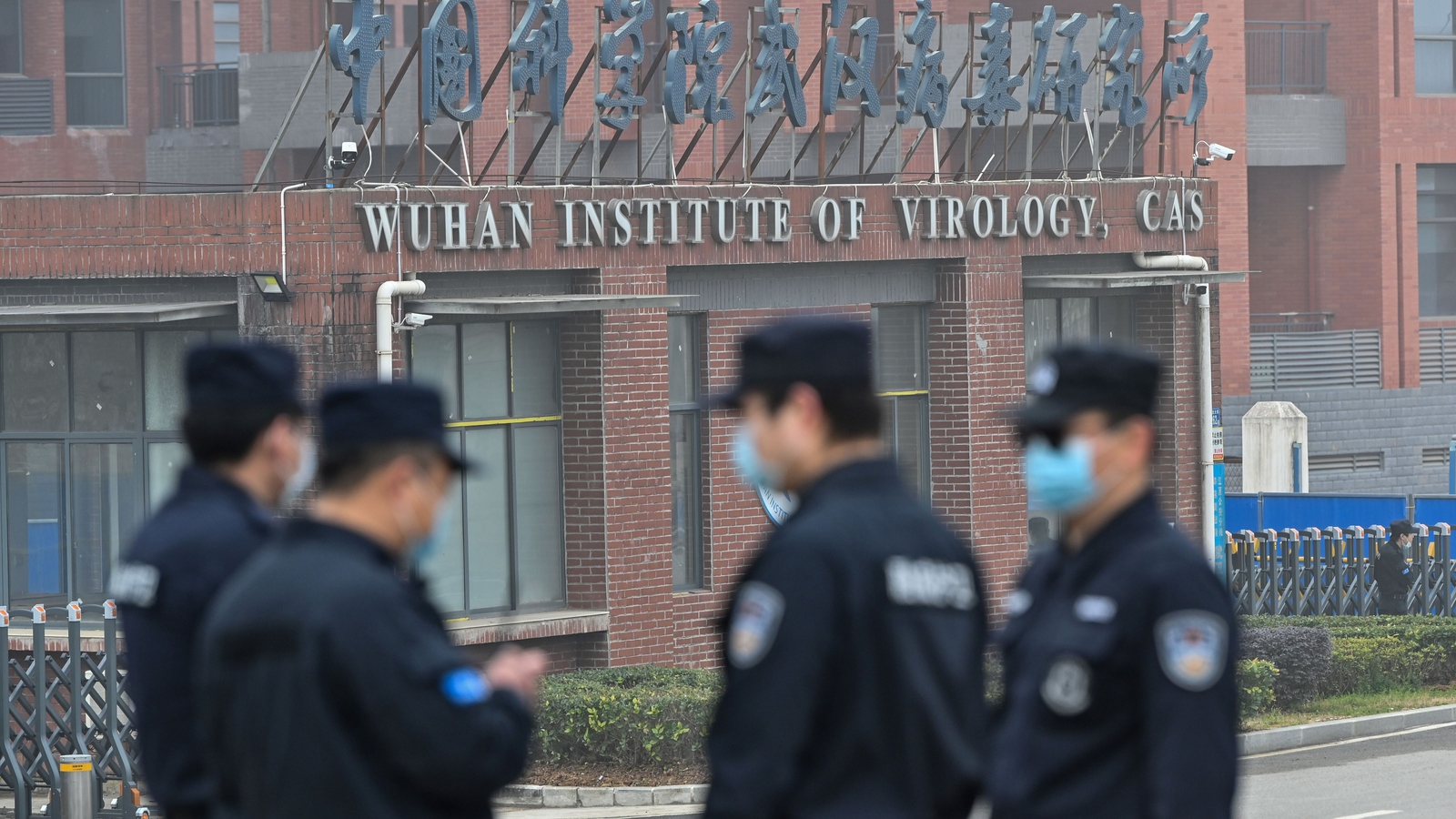 Image - Security stand guard outside the Wuhan Institute of Virology as members of the World Health Organisation visit the institute