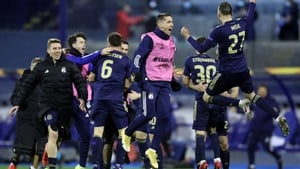 Dinamo Zagreb's players celebrate wildly at the final whistle