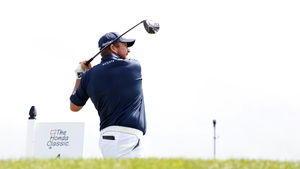 Shane Lowry plays his tee shot from the fourth on his third round at the Honda Classic