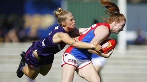 Lauren Magee is tackled by Jasmin Stewart of the Dockers