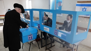 A man casts his ballot in the mostly Jewish ultra-Orthodox city of Bnei Brak