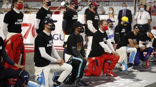 Drivers taking a knee before last November's Bahrain GP