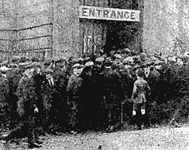 A group of unemployed people gathered outside the offices of the Ministry of Labour at the Rotunda in Dublin Photo: Freeman's Journal, 8 January 1921