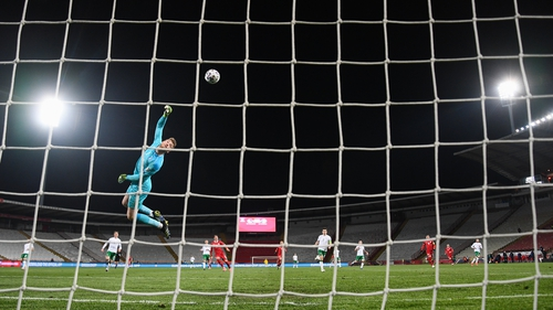 Mark Travers can only watch Aleksandar Mitrovic's lob sail into the net to make it t2-1 to Serbia on the night