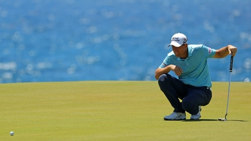 Padraig Harrington lines up a putt on the eighth green