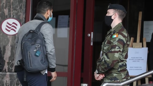 A traveller enters the Crowne Plaza hotel, Santry, near Dublin Airport, where he will stay during a mandatory 12-day quarantine