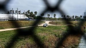 US Border Patrol cars patrol along the border with Mexico