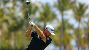 Graeme McDowell plays his tee shot on the 16th hole