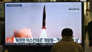 Footage of North Korea's tactical guided projectile test is shown on TV screens in Seoul, south Korea