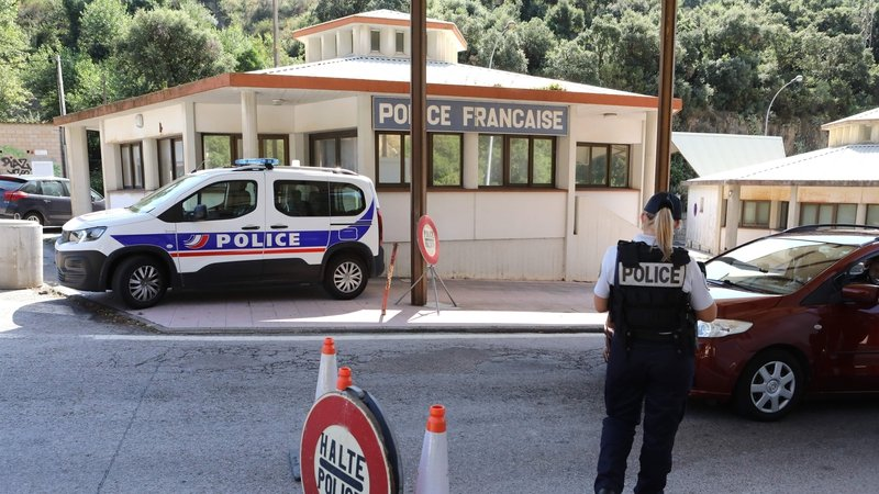 A French police officer controls vehicles at the border point with Spain, in Le Perthus, southern France (file image)