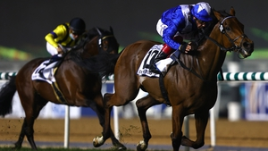 Frankie Dettori gives Lord North a pat down the neck as the duo cross the line in the Dubai Turf