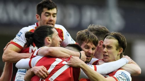 St Patrick's Athletic players mob Billy King after his winner