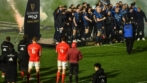 Munster players look on as Leinster celebrate another title