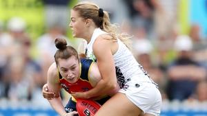 Collingwood's Sarah Rowe tackles Sarah Allan at Norwood Oval
