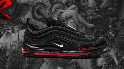 The black Nike Air Max 97s have been customised to feature a bronze pentagram, a Bible verse referring to Satan's fall and a drop of human blood mixed with red ink in the midsole (Pic: MSCHF website)
