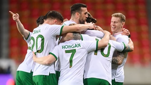 James McClean is mobbed after his goal