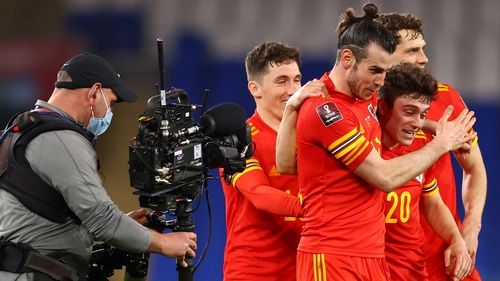 Gareth Bale celebrates the victory with match-winner Daniel James