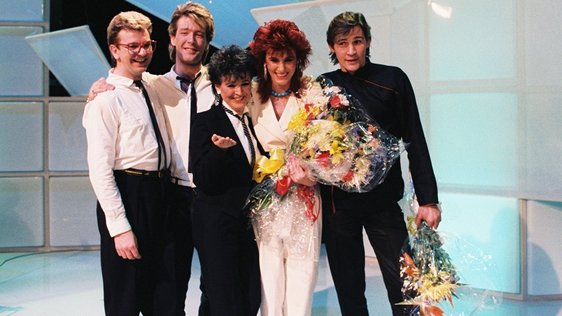 Irish singer Linda Martin (second right) with Johnny Logan (first right) and her backing singers, shortly after winning the 19th National Song Contest, in RTÉ Television's Studio 1 on 31 March 1984