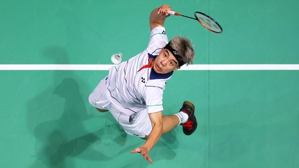 Nhat Nguyen of Ireland returning a shot during his round-of-16 match against Mark Caljouw at the All-England Open on 18 March