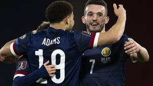 Che Adams celebrates with John McGinn