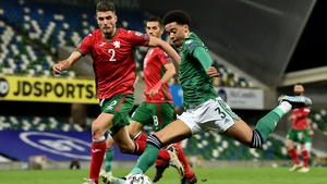 Jamal Lewis of Northern Ireland is challenged by Petko Hristov