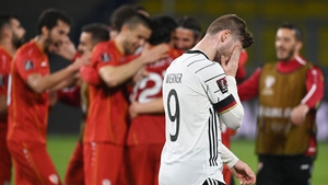 North Macedonia players celebrate as a dejected Timo Werner heads for the tunnel