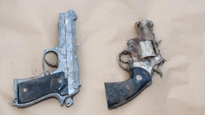 Gardaí attended the scene and found a suspected revolver and a semi-automatic pistol