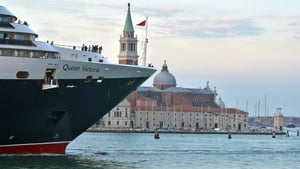 The cruise ship 'Queen Victoria' passes close to St Mark's Square in Venice in September 2013