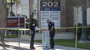 Police near the scene where four people were killed in Orange, California