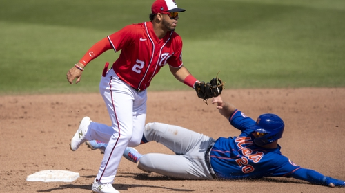Washington's Luis Garcia (2) tags out Mets infielder Pete Alonso during a spring training game last month.