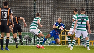 Alan Mannus pulls off a save at Tallaght Stadium.