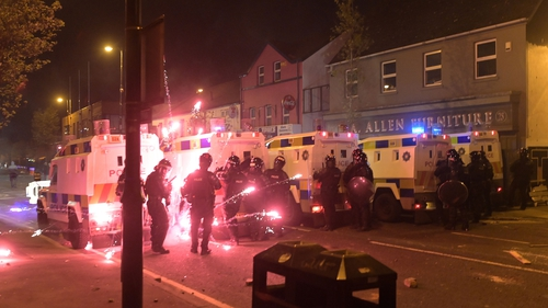 Around 100 people gathered and bricks, bottles and fireworks were thrown at police