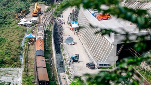 An overview of the damaged train lifted and removed from a track for clearance after derailing in a tunnel