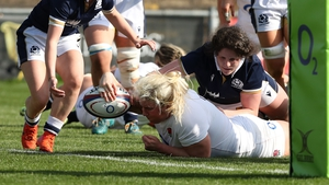 Bryony Cleall of England scores their team's fourth try