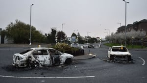 Burnt out cars at the Cloughfern roundabout following overnight violence in Belfast