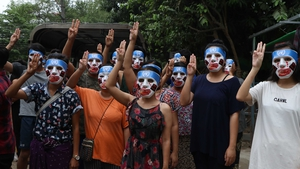 Protesters in masks at a rally in Yangon