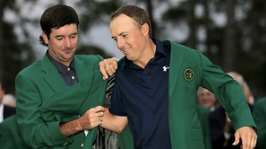 Bubba Watson helps Jordan Spieth put on the famous green jacket after he won the 2015 Masters