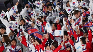 Delegations from North Korea and South Korea march under the Korean unification flag during the closing ceremony of the Pyeongchang 2018 Winter Olympic Games