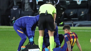 The Brazilian receiving treatment on the pitch against Eibar