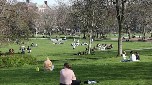 People enjoy the spring sunshine in Dublin's Merrion Park