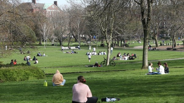 People enjoy the spring sunshine in Dublin's Merrion Park