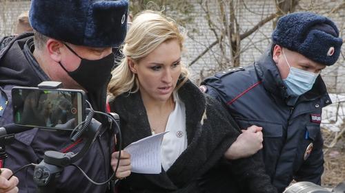 Anastasia Vasilyeva is removed by police when she tried to visit Alexei Navalny in prison