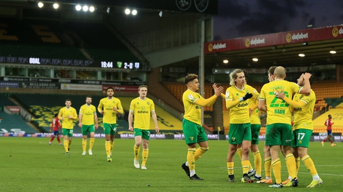 Teemu Pukki is mobbed after scoring his team's second goal