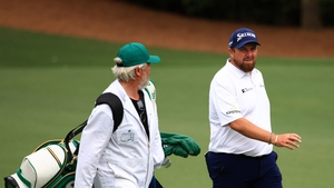 Lowry of Ireland and his caddie Brian Martin
