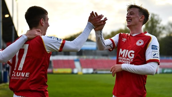 Darragh Burns (L) celebrates with Chris Forrester after scoring his side's second goal