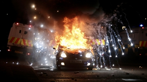 Police were attacked with missiles and a car was set on fire at Tiger's Bay, a loyalist area in north Belfast