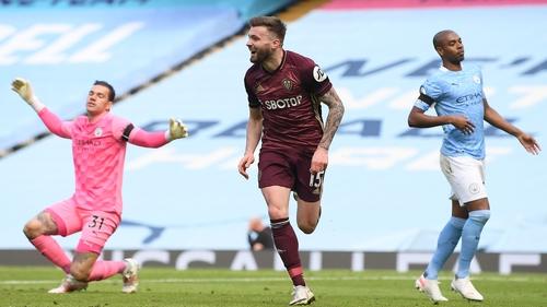 Stuart Dallas celebrates after scoring the injury-time winner for Leeds United