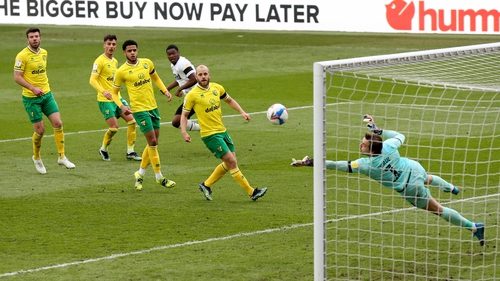 Omobamidele (centre) watches as Norwich keeper Tim Krul makes a late save against Derby