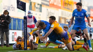 Jordan Larmour grounds the ball for Leinster's third try despite the tackle of Joe Simmonds