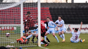 Drogheda's Mark Doyle (hidden) scores his side's first goal.